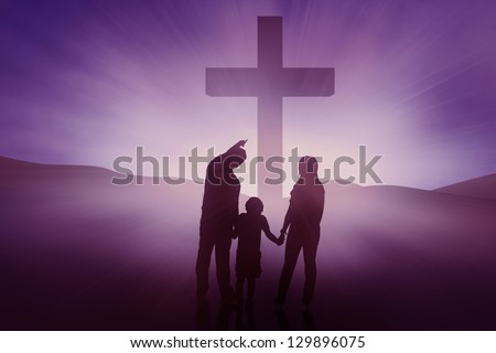 Silhouette of Christian family on blue background, horizontal shot