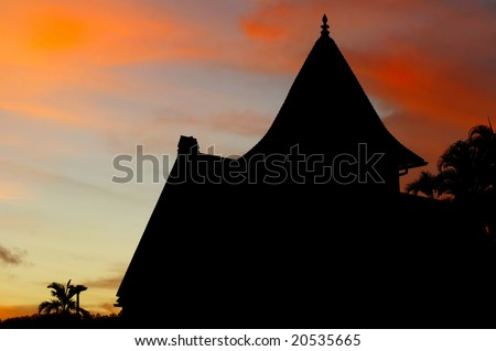 Silhouette of church in Hanalei, Kauai, against the sunrise