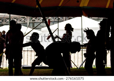 Silhouette of circus performers practicing juggling before the show