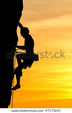 silhouette of climber - stock photo