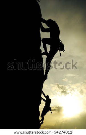 Silhouette of climber at the sunset. Element of design. - stock photo