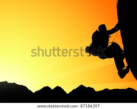 Silhouette of climbing young adult at the top of summit with aerial view on mountain range and sun ray