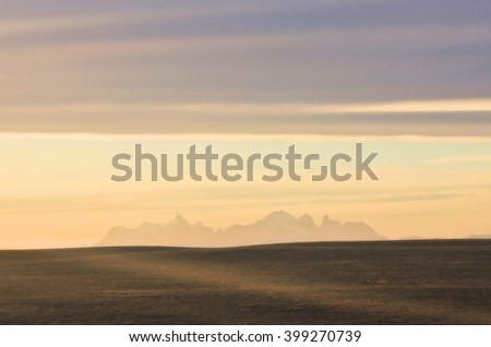 silhouette of colorfull sunset above patagonia mountains  - stock photo