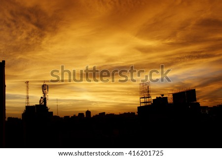 Silhouette of communication antenna against beautiful sky