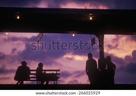 Silhouette of commuters on train platform, Chicago, IL - stock photo