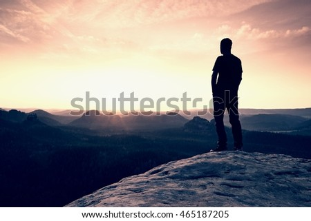 Silhouette of Confident and Powerful Man Standing with Hands on Hips, Late Day Sun with Copy Space