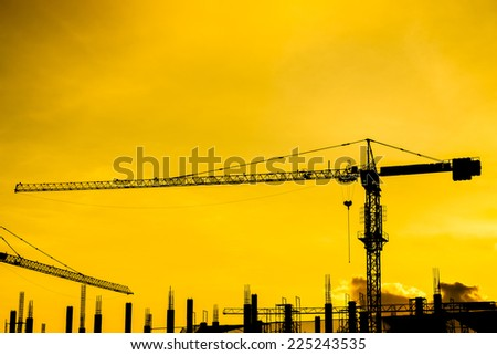 silhouette of construction site on evening background - stock photo