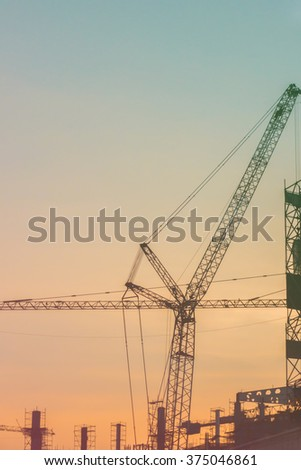 Silhouette of Construction site on sunset background