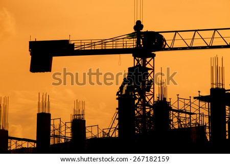 silhouette of construction worker on construction site. - stock photo