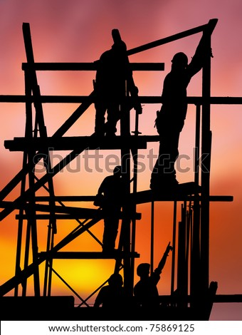 Silhouette of construction workers on scaffold working against a vivid and colorful sunset - stock photo