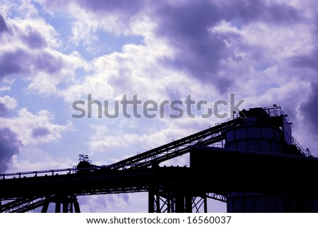 Silhouette of conveyor belt at factory, Greenwich Peninsula, London England UK - stock photo