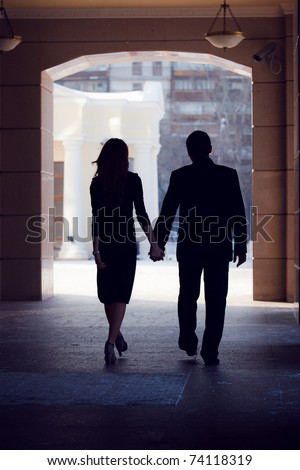 silhouette of couple walking