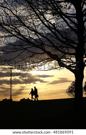Silhouette Of Couple walking back home During Sunset