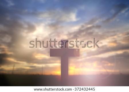 Silhouette of Cross over sunset concept for religion, worship, Christmas, Easter, thanksgiving prayer and praise. - stock photo