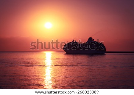 Silhouette of Cruise Ship at Sunset. Luxury Travel Concept. Toned and Filtered Photo. Copy Space. - stock photo