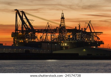 Silhouette of dock- and shipbuilding company at sunset - stock photo