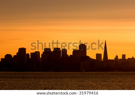 Silhouette of downtown San Francisco at sunset - stock photo