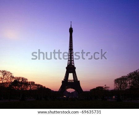 Silhouette of Eiffel Tower in the evening. The Eiffel tower is the most visited monument of France. - stock photo