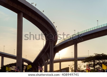 Silhouette of elevated expressway at twilight. - stock photo