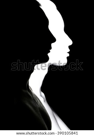 Silhouette of face man and woman. - stock photo