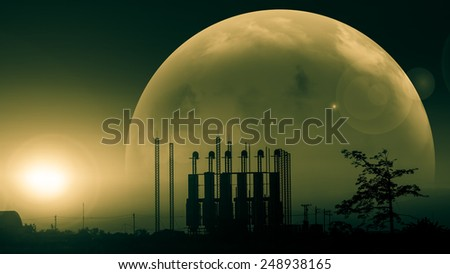 Silhouette of factory at sunset.Fantasy world.Image of earth planet. Elements of this image are furnished by NASA - stock photo