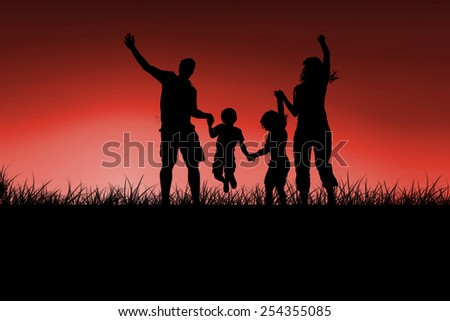 Silhouette of family jumping against red sky over grass - stock photo