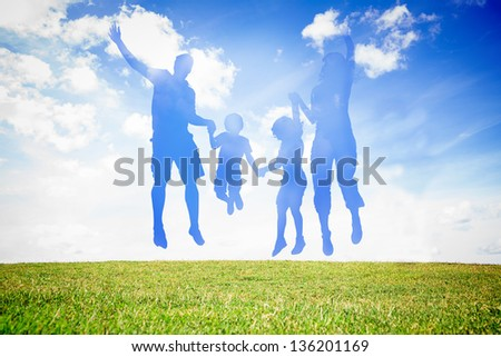 Silhouette of family jumping in the air against sky background - stock photo