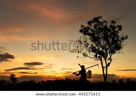Silhouette of farmer pointing at sky for dreaming. dark tone image.