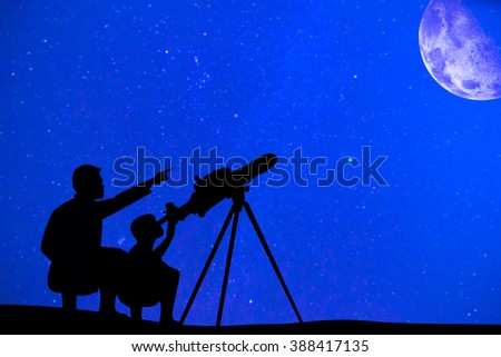 Silhouette of father and son looking moon through a telescope at beautiful night sky - stock photo