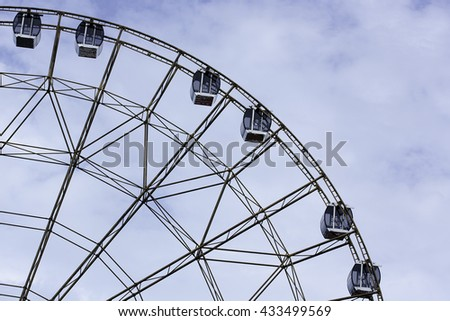silhouette of Ferris wheel on blue sky background, rhythm, Sochi, Russia. with space for text