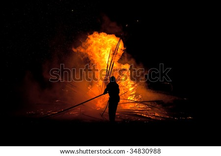 Silhouette of fireman - stock photo