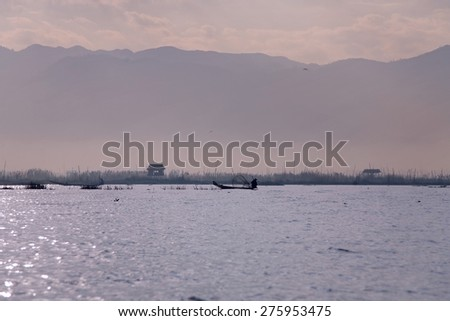 Silhouette of Fisherman in inle lake, Myanmar - stock photo