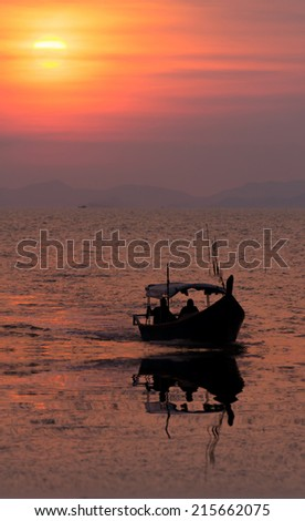 silhouette of fisherman's boat - stock photo