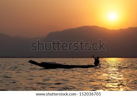 silhouette of fishermen in Myanmar - stock photo