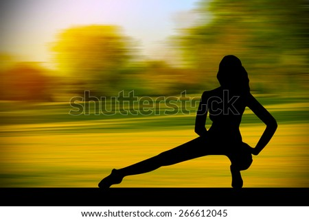 Silhouette of fitness women with nature background