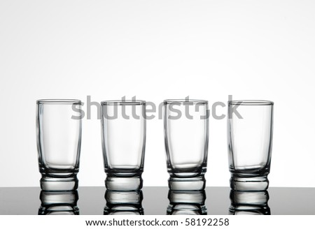 Silhouette of four shot glasses
