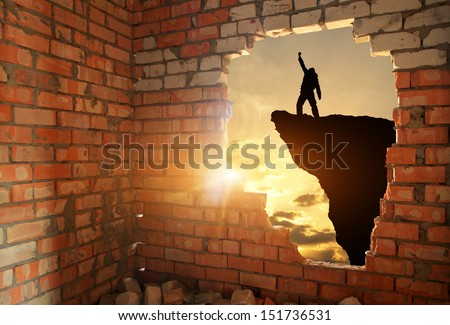Silhouette of free man. Conceptual composition. - stock photo
