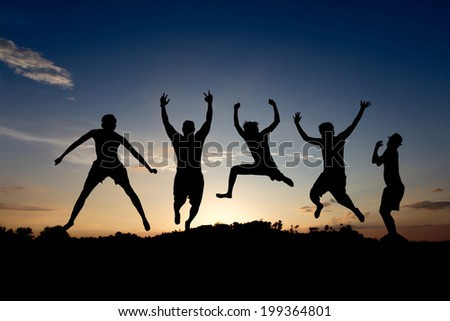 silhouette of friends jumping