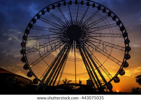 Silhouette of giant ferris wheel in Bangkok, Thailand