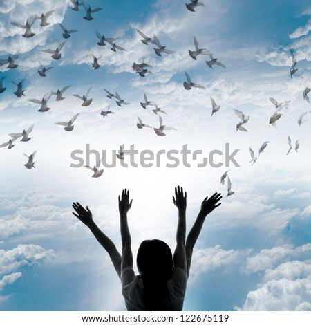 Silhouette of girl and flying dove on sky background, freedom and peace concept