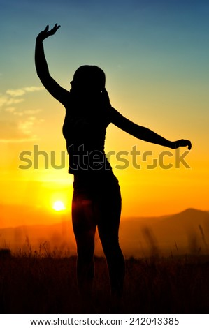 Silhouette of girl in sunset