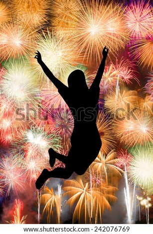 Silhouette of girl jumping happy enjoy brightly colorful fireworks in the night sky - stock photo