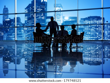 Silhouette of Global Business Meeting with Cityscape - stock photo