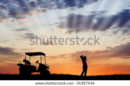 Silhouette of golfer and golf cart - stock photo