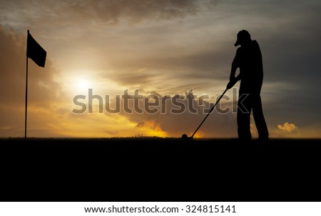 silhouette of golfers hit sweeping and keep golf course in the s - stock photo