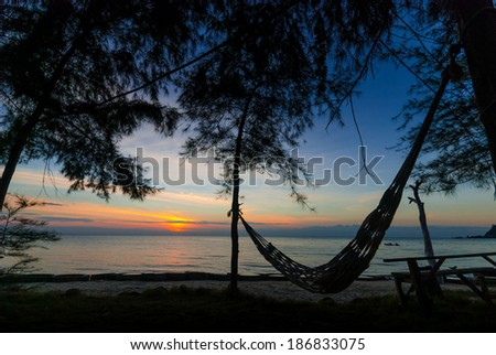 silhouette of hammock on the beach - stock photo