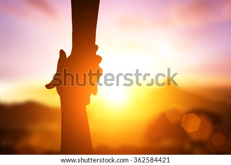 silhouette of hand help and hope concept - stock photo