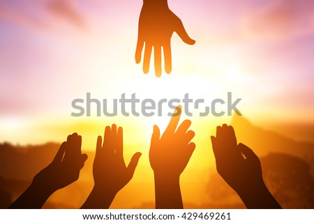 silhouette of hand help and hope concept and helping hand - stock photo