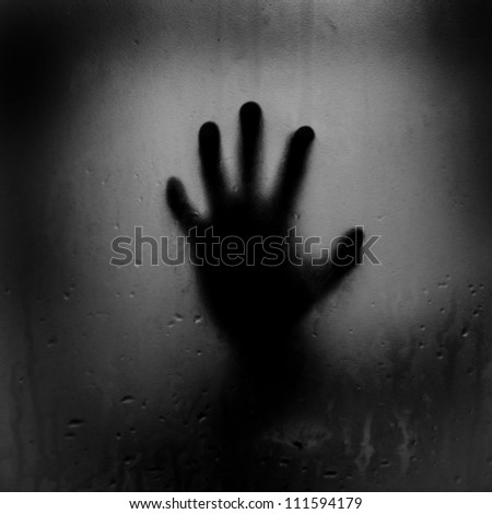 silhouette of hand with glass - stock photo