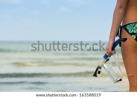 Silhouette of hand with snorkeling equipment - picture with space for text. - stock photo